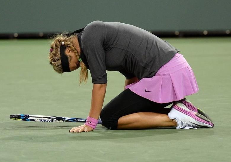 Mar 7, 2014; Indian Wells, CA, USA;  Victoria Azarenka (BLR) grimaces as she lands on her left ankle during her match against Lauren Davis (not pictured) at the BNP Paribas Open at the Indian Wells Tennis Garden.  Jayne Kamin-Oncea-USA TODAY Sports