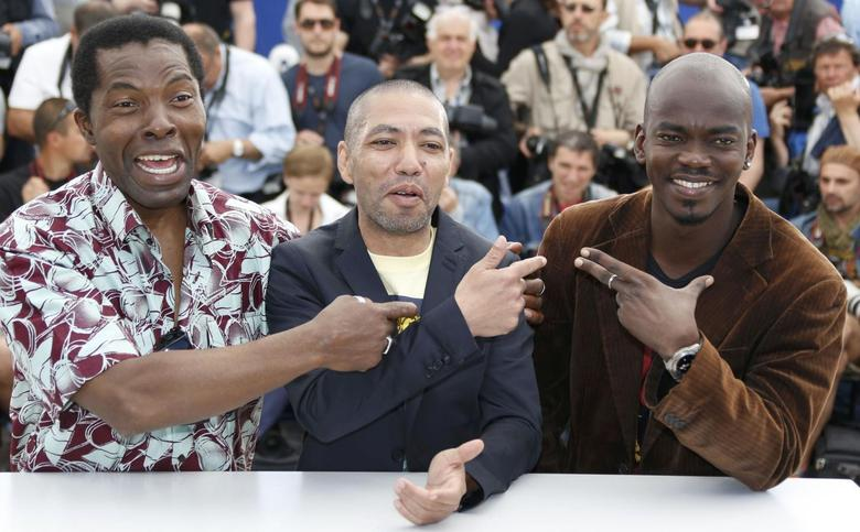 Director Philippe Lacote (C), cast member Isaach De Bankole (L) and actor Abdoul Karim Konate (R) pose during a photocall for the film ''Run'' in competition for the category ''Un Certain Regard'' at the 67th Cannes Film Festival in Cannes May 17, 2014.      REUTERS/Regis Duvignau