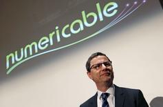 Le PDG de Numericable, Éric Denoyer, a déclaré mardi que Le cablo-opérateur ne prévoyait pas de rapprochement avec l'opérateur Bouygues Telecom, avec lequel il a des accords commerciaux, préférant se concentrer sur la mise en oeuvre du récent rachat de SFR. /Photo prise le 12 mars 2014/REUTERS/Jacky Naegelen