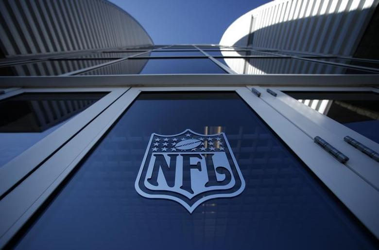 The NFL logo appears on an entrance door to the football stadium at Super Bowl XLII in Glendale, Arizona February 2, 2008.