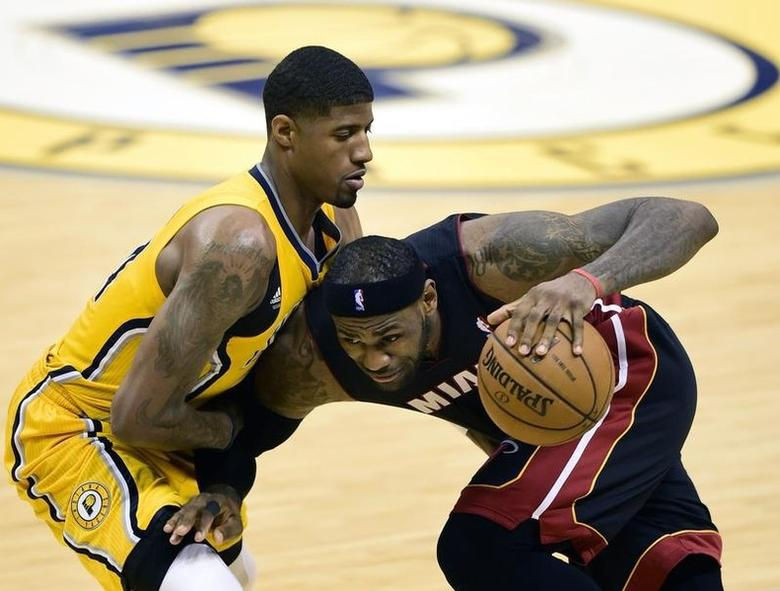 May 20, 2014; Indianapolis, IN, USA; Miami Heat forward LeBron James (6) drives towards the basket against Indiana Pacers forward Paul George (24) during the second half of game two of the Eastern Conference Finals of the 2014 NBA Playoffs at Bankers Life Fieldhouse. The Miami Heat beat the Indiana Pacers 87 to 83.  Marc Lebryk-USA TODAY Sports