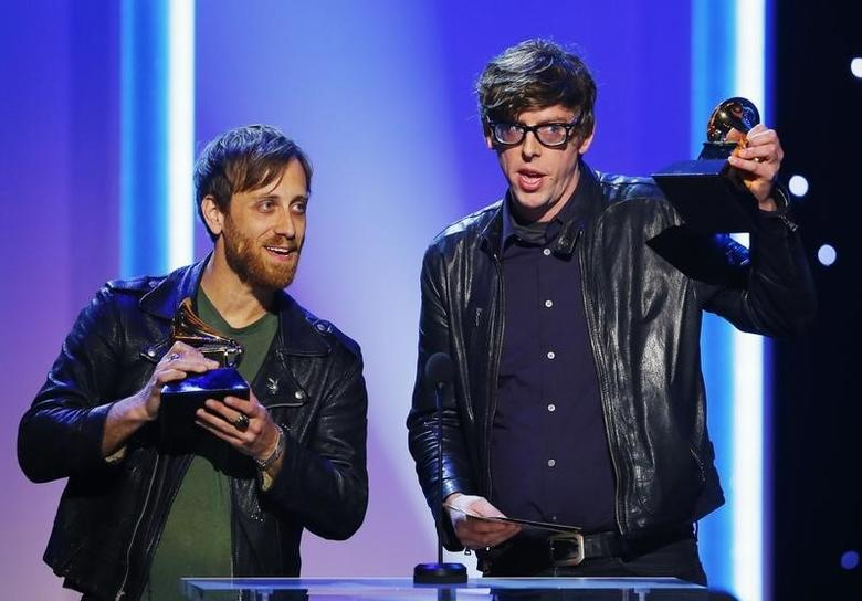 Black Keys members Dan Auerbach and Patrick Carney (R) accept their awards for best rock album and best rock song at the 55th annual Grammy Awards in Los Angeles, California, February 10, 2013.      REUTERS/Mike Blake