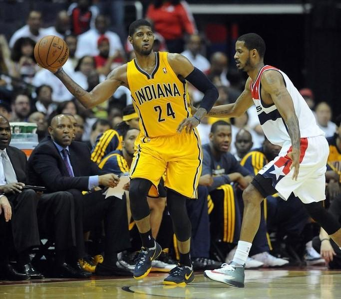May 15, 2014; Washington, DC, USA; Indiana Pacers small forward Paul George (24) passes the ball as Washington Wizards small forward Trevor Ariza (1) defends during the second half in game six of the second round of the 2014 NBA Playoffs at Verizon Center. The Pacers won 93-80. Mandatory Credit: Brad Mills-USA TODAY Sports