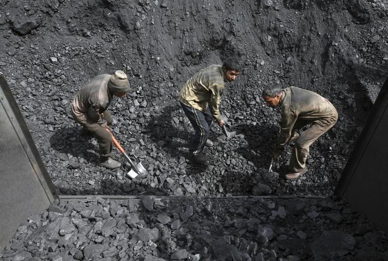 Labourers load coal on trucks at Bari Brahamina on the outskirts of Jammu March 16, 2012. REUTERS/Mukesh Gupta/Files