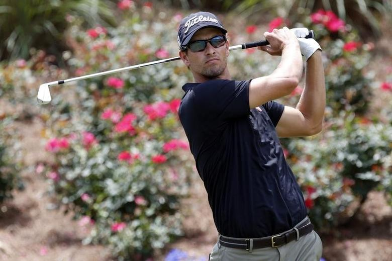 May 10, 2014; Ponte Vedra Beach, FL, USA; Adam Scott tees off on the 18th hole during the third round of The Players Championship at TPC Sawgrass - Stadium Course. Mandatory Credit: Geoff Burke-USA TODAY Sports