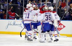 May 22, 2014; New York, NY, USA; Montreal Canadiens goalie Dustin Tokarski (35) celebrates with his teammates after defeating the New York Rangers in game three of the Eastern Conference Final of the 2014 Stanley Cup Playoffs at Madison Square Garden. Andy Marlin-USA TODAY Sports