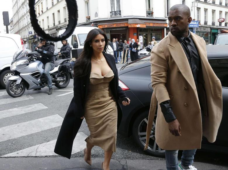 TV personality Kim Kardashian and rapper Kanye West arrive at a fashion designer workshop in Paris May 21, 2014.    REUTERS/Gonzalo Fuentes