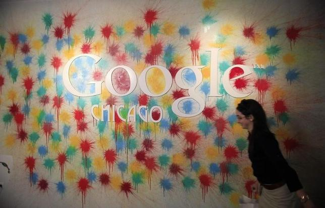 A woman walks past the Google Chicago headquarters logo in Chicago, March 20, 2012. REUTERS/Jim Young/Files