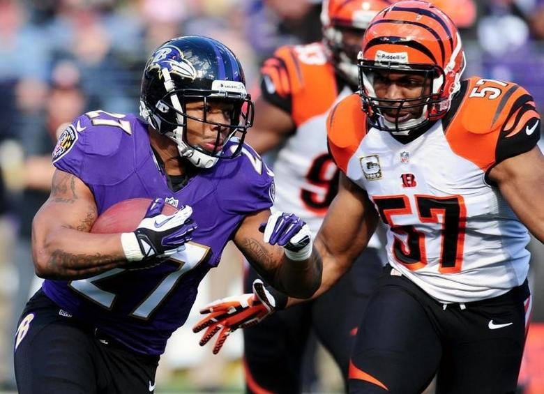 Nov 10, 2013; Baltimore, MD, USA; Baltimore Ravens running back Ray Rice (27) runs with the ball as Cincinnati Bengals linebacker Vincent Rey (57) defends at M&T Bank Stadium. Mandatory Credit: Evan Habeeb-USA TODAY Sports
