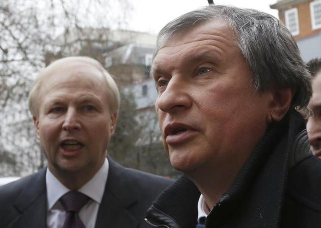 British Petroleum CEO Bob Dudley and Rosneft CEO Igor Sechin (R) speak to journalists as they arrive outside the BP headquarters in central London March 21, 2013. REUTERS/Olivia Harris