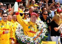 May 25, 2014; Indianapolis, IN, USA; IndyCar Series driver Ryan Hunter-Reay celebrates after winning the 2014 Indianapolis 500 at Indianapolis Motor Speedway.  Mark J. Rebilas-USA TODAY Sports
