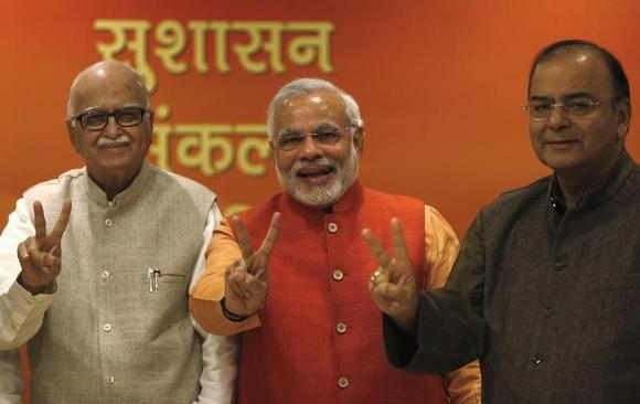 BJP leaders LK Advani, Narendra Modi, and Arun Jaitley show victory signs before their meeting in New Delhi December 8, 2013. REUTERS/Ahmad Masood/Files
