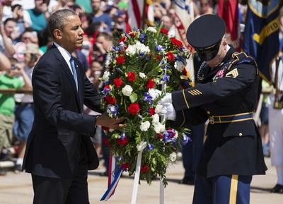 With nod to veterans' scandal, Obama pays Memorial Day...