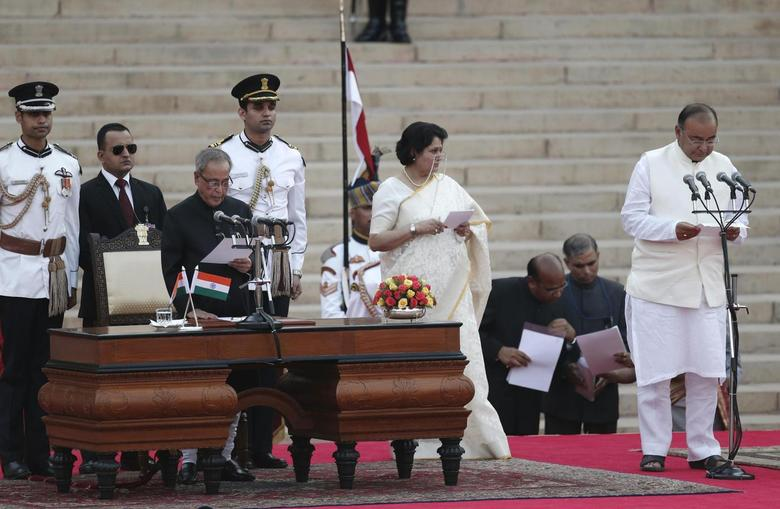 President Pranab Mukherjee (3rd L) administers the oath of office to Arun Jaitley (R) as a cabinet minister at Rashtrapati Bhavan in New Delhi May 26, 2014. REUTERS/Adnan Abidi