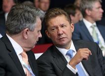 Глава Газпрома Алексей Миллер на деловом форуме в Санкт-Петербурге 23 мая 2014 года. Госкомпании Литвы в среду предложили Газпрому продать доли в газовых компаниях страны, ранее договорившись о выкупе долей немецкой E.ON. REUTERS/Sergei Karpukhin