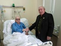 Former Polish President Lech Walesa (R) shakes hands with with former President General Wojciech Jaruzelski at a military hospital in Warsaw September 24, 2011 in this handout image received by Reuters September 26, 2011. Jaruzelski was hospitalised for pneumonia following chemotherapy for lymphoma, local media reported. Picture taken September 24, 2011. REUTERS/lechwalesa.blip.pl/Handout  (POLAND - Tags: POLITICS HEALTH) FOR EDITORIAL USE ONLY. NOT FOR SALE FOR MARKETING OR ADVERTISING CAMPAIGNS. THIS IMAGE HAS BEEN SUPPLIED BY A THIRD PARTY. IT IS DISTRIBUTED, EXACTLY AS RECEIVED BY REUTERS, AS A SERVICE TO CLIENTS - RTR2RV2K