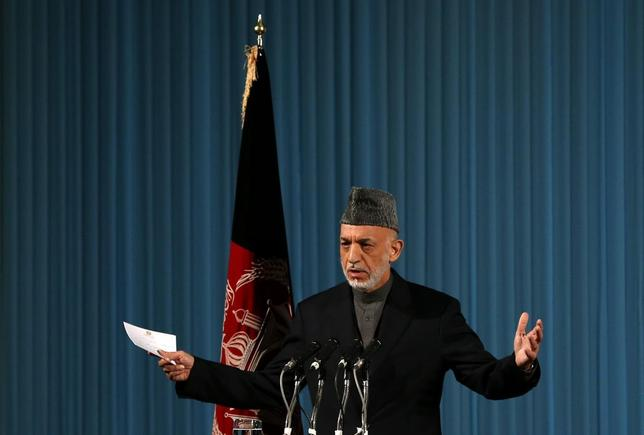 Afghanistan's incumbent President Hamid Karzai speaks during a cultural event in Kabul May 15, 2014. REUTERS/Omar Sobhani