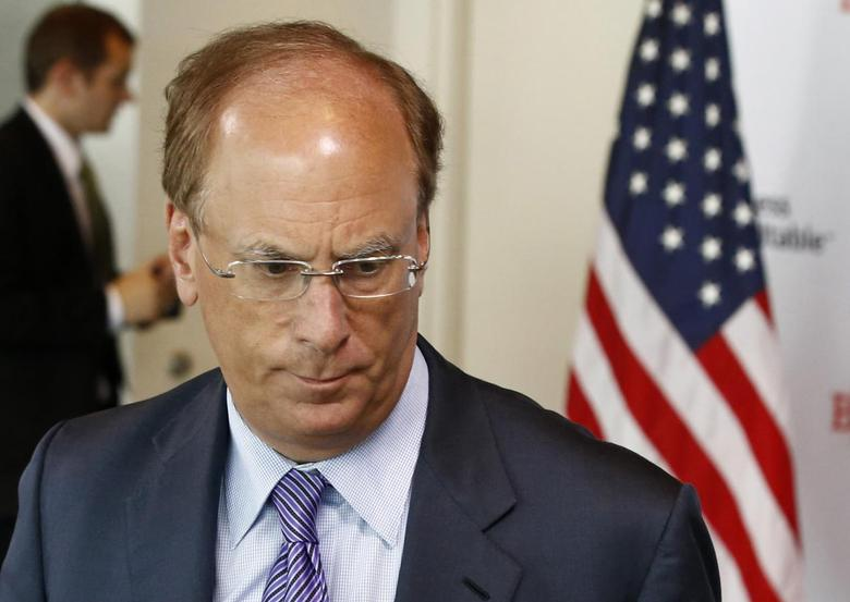 BlackRock Inc Chief Executive Officer Larry Fink is pictured at a business roundtable meeting of company leaders and U.S. Republican Presidential candidate Mitt Romney in Washington in this June 13, 2012 file photo.  REUTERS/Jason Reed