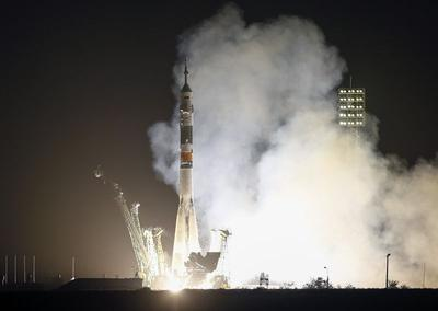 Multinational crew blasts off, arrives at space...