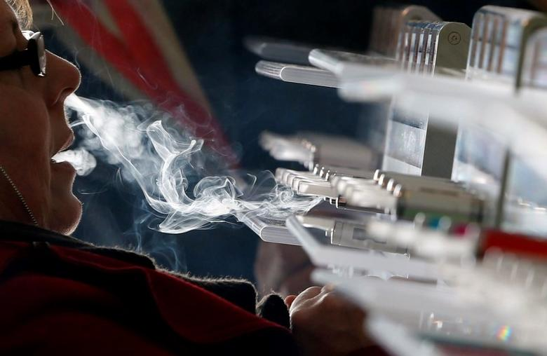 A customer tests e-liquids for e-cigarettes during the first international fair of electronic cigarette and vapology ''Vapexpo'' in Bordeaux, southwestern France, March 13, 2014.  REUTERS/Regis Duvignau