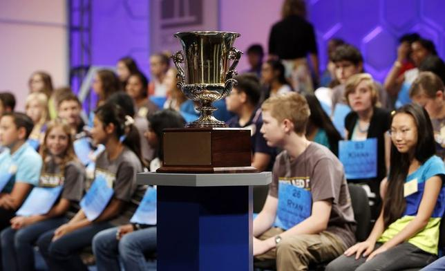 Spelling contestants sit on stage behind the winning trophy before round two of the preliminary rounds at the Scripps-Howard National Spelling Bee at National Harbor, Maryland May 28, 2014. REUTERS/Gary Cameron