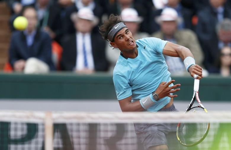 Rafael Nadal of Spain serves to Robby Ginepri of the U.S. during their men's singles match at the French Open tennis tournament at the Roland Garros stadium in Paris May 26, 2014.        REUTERS/Vincent Kessler
