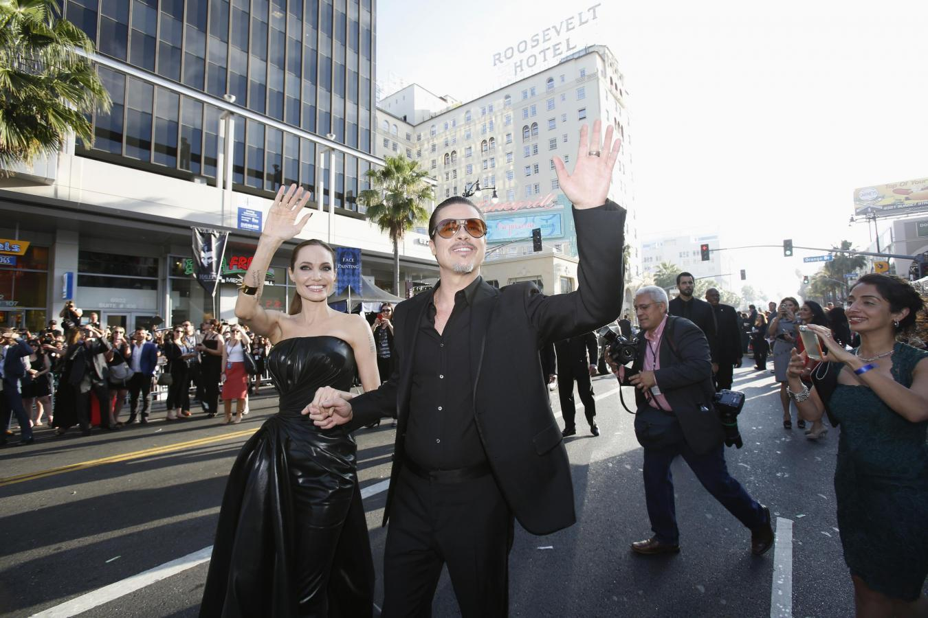 """Prankster hits Brad Pitt in the face at """"Maleficent"""" premiere"""