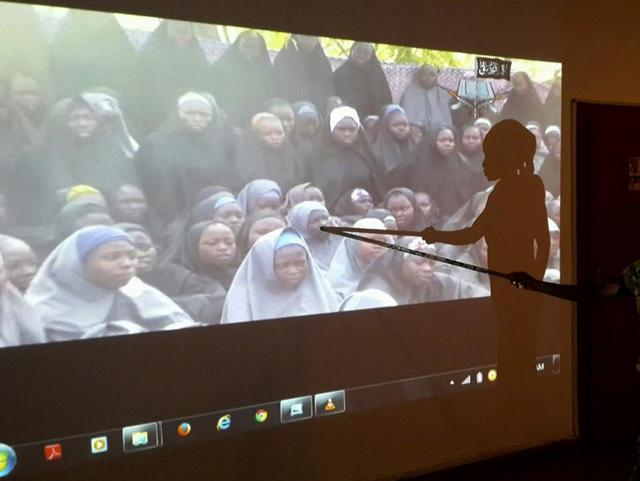 A student who escaped when Boko Haram rebels stormed a school and abducted schoolgirls, identifies her schoolmates from a video released by the Islamist rebel group at the Government House in Maiduguri, Borno State in this May 15, 2014 file photo. REUTERS/Stringer/Files