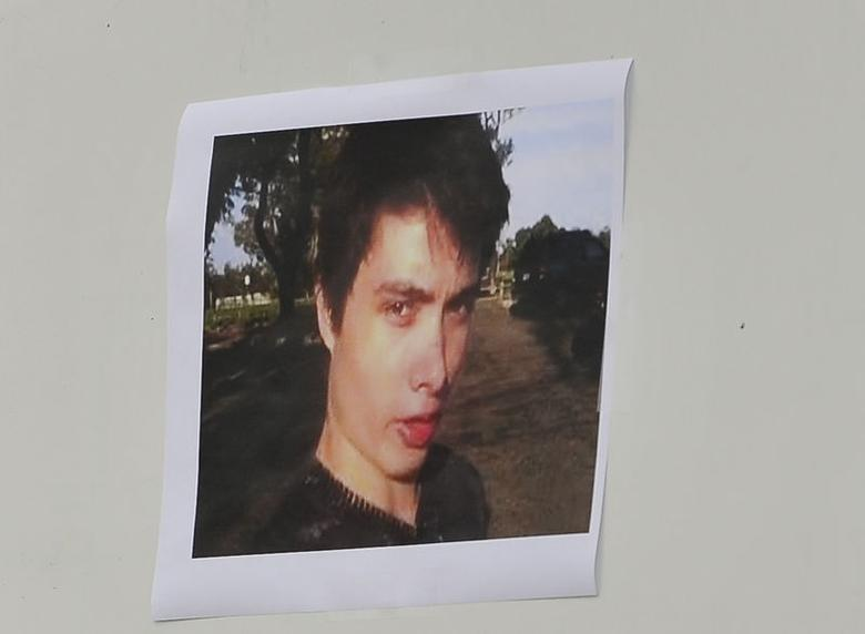 A picture of Elliot Rodger is displayed during a news conference by Santa Barbara County Sheriff Bill Brown (not shown) at Sheriff headquarters in Santa Barbara, California May 24, 2014.  REUTERS/Phil Klein