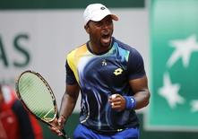 Donald Young of the U.S. reacts during his men's singles match against Feliciano Lopez of Spain at the French Open tennis tournament at the Roland Garros stadium in Paris May 29, 2014.  REUTERS/Stephane Mahe