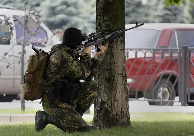 Ukraine separatists down army helicopter, 14 killed