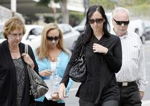 (L-R) Ann Stow, mother, Erin Collins and Bonnie Stow, sisters, and David Stow, father, of San Francisco Giants fan Bryan Stow arrive for the start of a civil trial in a lawsuit brought by Stow against former Los Angeles Dodgers owner Frank McCourt at a Los Angeles Court in Los Angeles, California May 29, 2014. REUTERS/Kevork Djansezian