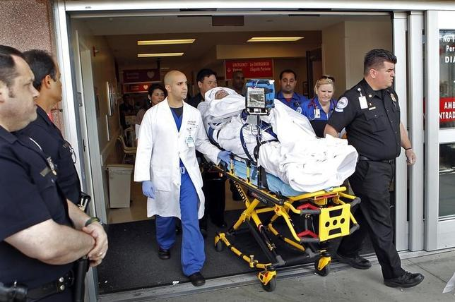 Bryan Stow, a Santa Clara, California area paramedic and San Francisco Giants fan, who suffered brain damage in an attack during the Giants-Los Angeles Dodgers opening day baseball game in March 2011 is moved to a waiting ambulance as he leaves the Los Angeles County-USC Medical center, May 16, 2011.  REUTERS/Al Seib/Los Angeles Times/Pool