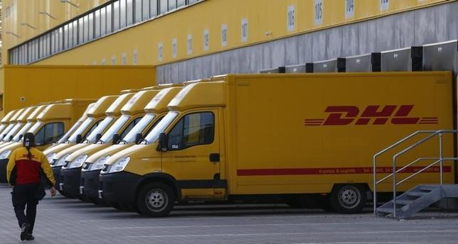 Trucks are parked at the new distribution centre of the German postal and logistics group Deutsche Post DHL in Berlin November 12, 2013. REUTERS/Tobias Schwarz