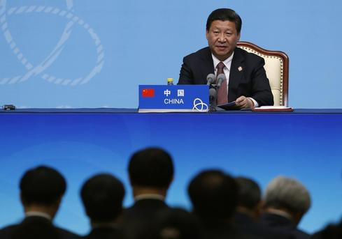 China's Xi vows to address poverty, ethnic unity in troubled Xinjiang