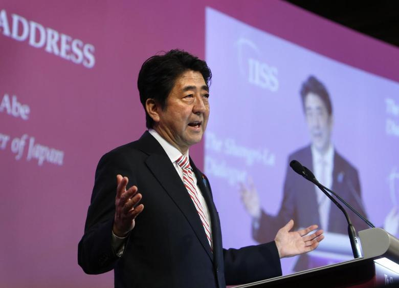 Japan's Prime Minister Shinzo Abe delivers the opening keynote address at the 13th International Institute for Strategic Studies (IISS) Asia Security Summit: The Shangri-La Dialogue, in Singapore May 30, 2014. REUTERS/Edgar Su