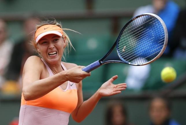 Maria Sharapova of Russia returns a forehand to Paula Ormaechea of Argentina during their women's singles match at the French Open tennis tournament at the Roland Garros stadium in Paris May 30, 2014.  REUTERS/Gonzalo Fuentes