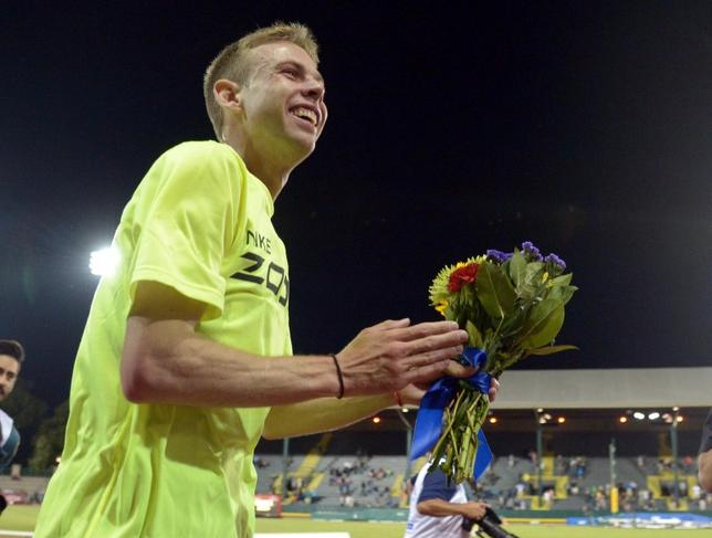 May 30, 2014; Eugene, OR, USA; Galen Rupp (USA) takes a victory lap after winning the 10,000m in an American record 26:44.36 in the 40th Prefontaine Classic at Hayward Field. Mandatory Credit: Kirby Lee-USA TODAY Sports