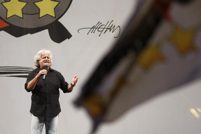 Leader of the Five Star Movement and comedian Beppe Grillo speaks during an election campaign rally for European parliament elections in Rome May 23, 2014.  REUTERS/Remo Casilli