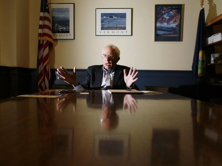 Senator Bernie Sanders (I-VT) is interviewed by a Reuters reporter at Sanders' office in Burlington, Vermont November 28, 2006. REUTERS/Brian Snyder