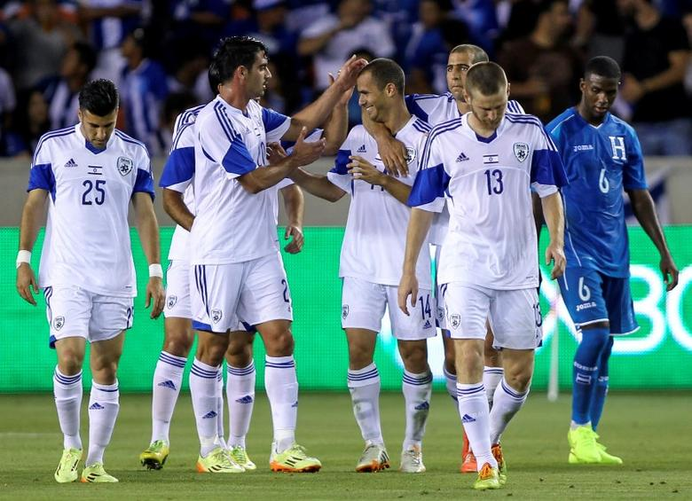Jun 1, 2014; Houston, TX, USA; Israel midfielder Neftali Vermouth Gil (14) is congratulated by teammates after scoring a goal against Honduras during the second half of a soccer friendly match at BBVA Compass Stadium. Israel defeated Honduras 4-2. Mandatory Credit: Troy Taormina-USA TODAY Sports