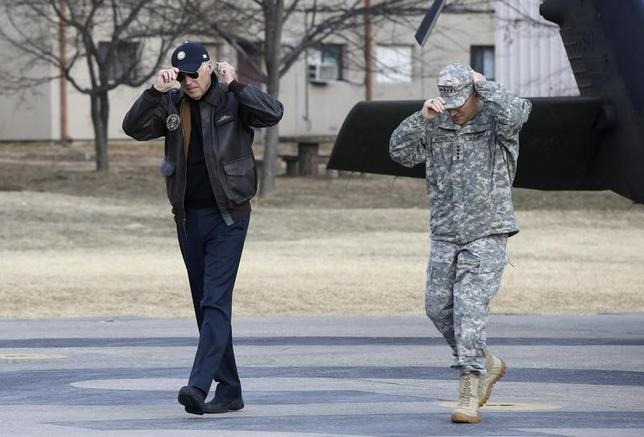 U.S. Vice President Joe Biden (L) and commander of combined U.S.-South Korea forces U.S. Army General Curtis Scaparrotti (R) wear their caps upon arrival at the Demilitarized Zone (DMZ), the military border separating the two Koreas, in Panmunjom December 7, 2013. REUTERS/Lee Jin-man/Pool