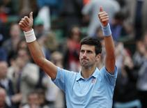 Novak Djokovic of Serbia celebrates after winning his men's singles match against Jo-Wilfried Tsonga of France at the French Open tennis tournament at the Roland Garros stadium in Paris June 1, 2014. REUTERS/Gonzalo Fuentes