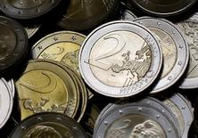 Two Euro coins are seen after being minted in the Austrian Mint (Muenze Oesterreich) headquarters in Vienna June 20, 2013. The Austrian mint was first mentioned in papers in 1371 and is located in Vienna.   REUTERS/Leonhard Foeger  (AUSTRIA - Tags: BUSINESS)