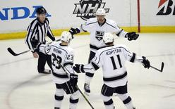 May 5, 2014; Anaheim, CA, USA; Los Angeles Kings right wing Marian Gaborik (12) celebrates with teammates Anze Kopitar (11) and Dustin Brown (23) after scoring a goal against the Anaheim Ducks during the first period in game two of the second round of the 2014 Stanley Cup Playoffs at Honda Center. Mandatory Credit: Richard Mackson-USA TODAY Sports - RTR3NWVH