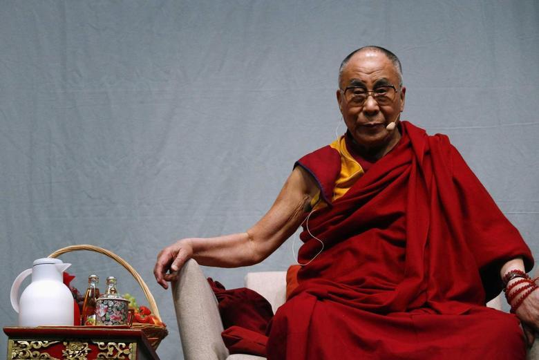 Tibetan spiritual leader the Dalai Lama looks on during a public talk at the Fraport Arena in Frankfurt May 14, 2014. REUTERS/Ralph Orlowski