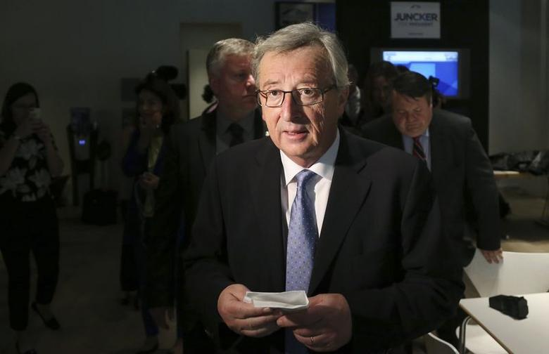 Candidate for the European Commission presidency Jean-Claude Juncker of the European People's Party leaves the party's headquarters in Brussels May 26, 2014. REUTERS/Francois Lenoir