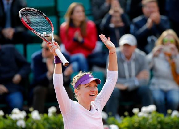 Simona Halep of Romania celebrates after winning her women's quarter-final match against Svetlana Kuznetsova of Russia at French Open tennis tournament at the Roland Garros stadium in Paris June 4, 2014. REUTERS/Stephane Mahe