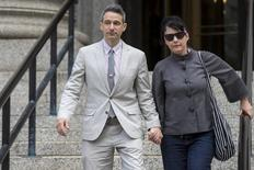 "Beastie Boys member Adam Horovitz, a.k.a. ""Ad-Rock,"", exits the U.S. District Court for the Southern District of New York in Lower Manhattan with his wife punk singer Kathleen Hanna, May 27, 2014. REUTERS/Brendan McDermid"