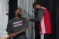Jun 4, 2014; San Antonio, TX, USA; Miami Heat forward LeBron James (6) talks with Miami Heat guard Dwyane Wade (3) before practice before game one of the 2014 NBA Finals against the San Antonia Spurs at the AT&T Center. Mandatory Credit: Bob Donnan-USA TODAY Sports